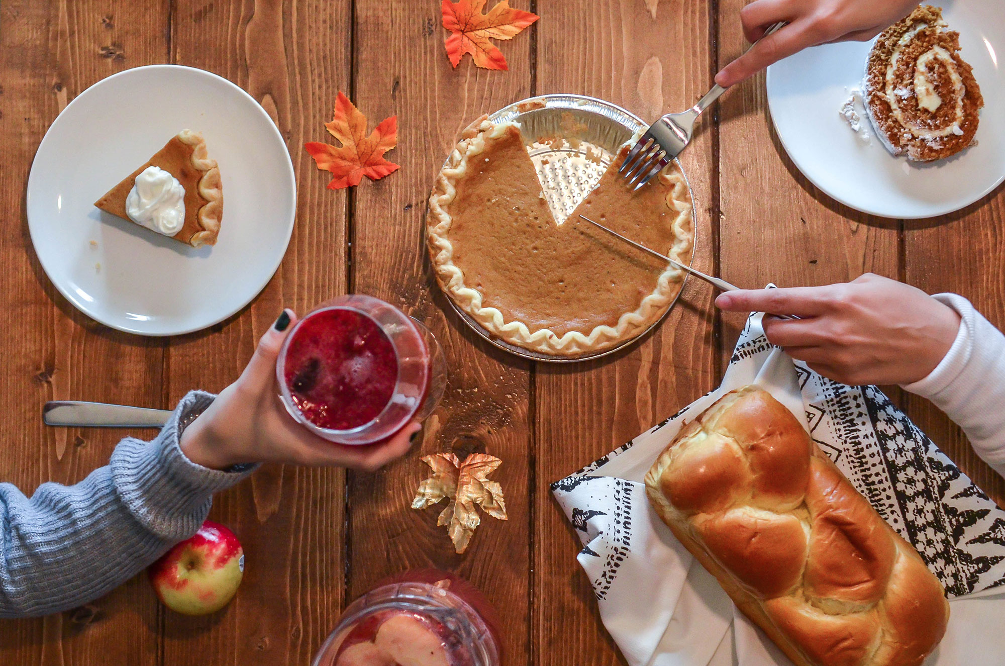 Table with pumpkin pie and bread
